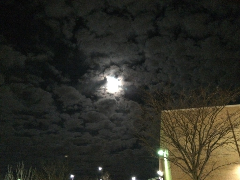 "The moon glows through the clouds making a ""Spooky Eye"""