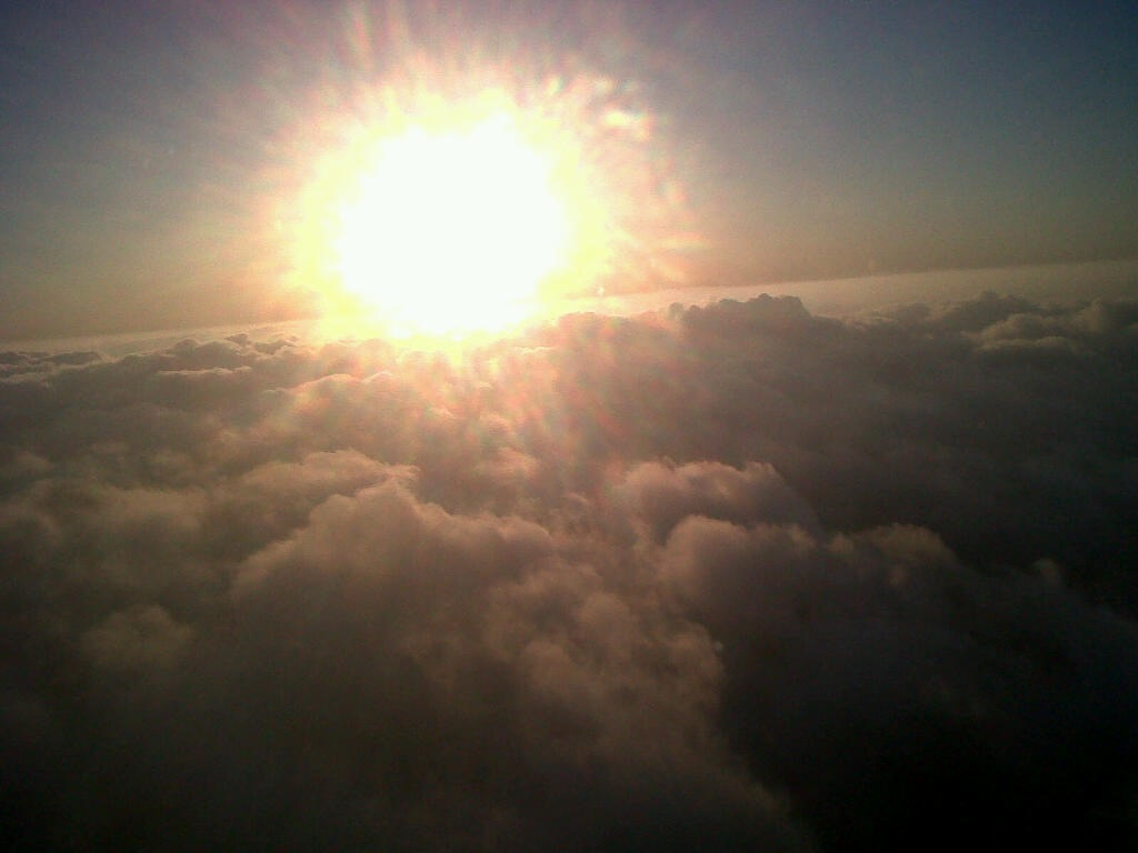 Sun over the clouds taken from an airplane (as we made contrails??)