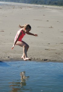 Livvy taking a dive into a pool of water at the beach in Washington 2015