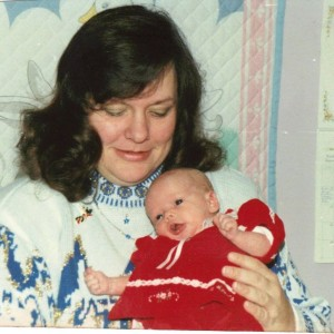 A young Holly with her mother
